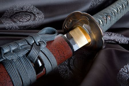 samurai: Real Japanese samurai sword on black silk Stock Photo