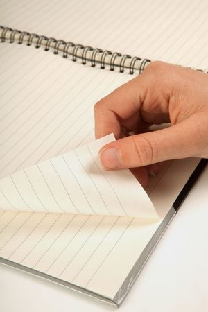Female hand turning a page of an empty notebook Stock Photo - 5954070