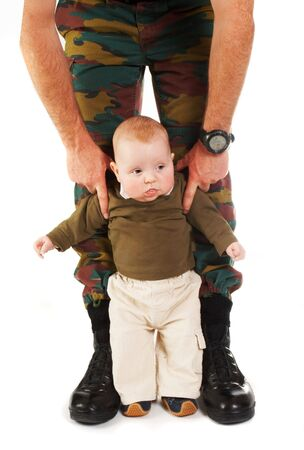 Soldier father and his four month old son photo