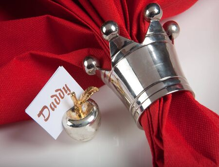 Festive Christmas or wedding table with red napkins on a white tablecloth photo