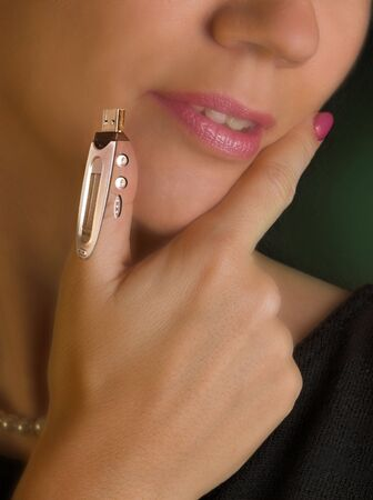 Young bionic woman with usb memory stick integrated in her thumb Stock Photo - 5984241
