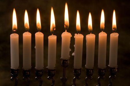 chanukiah: Nince candles in a jewish hanukkah candle-holder Stock Photo
