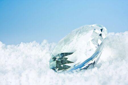 Large diamond shape lying in white snow Stock Photo