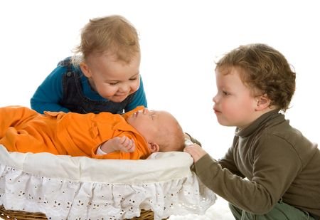 Two toddlers admiring their newborn little sister Stock Photo - 6116416