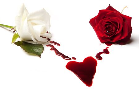 bleeding: Two bleeding roses forming a heart shaped blood stain Stock Photo