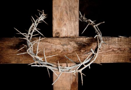 crowns: Crown of thorns hung around the Easter cross