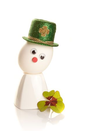 Egg with St. Patrick's hat and clover leaf Stock Photo - 6192682