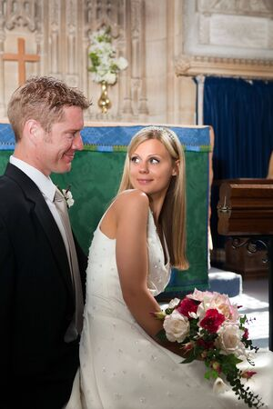 Newly wed couple posing in an English medieval church Stock Photo - 6191428