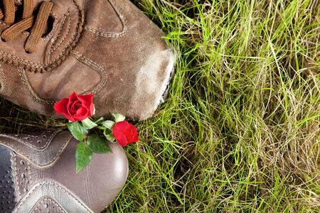 Woman's shoe and man's boot in love with two red roses Stock Photo - 6192742