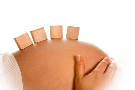 Little wooden building blocks on pregnant belly with space for baby name Stock Photo - 6297136