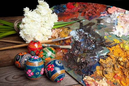 Painter's pallet with brushes and russian easter eggs Stock Photo - 6341823