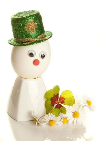Egg with saint patrick's hat and clover leaf Stock Photo - 6382839
