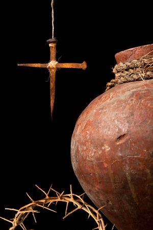 holy jug: Antique wine jug and an easter cross made of rusty nails symbols of the resurrection Stock Photo