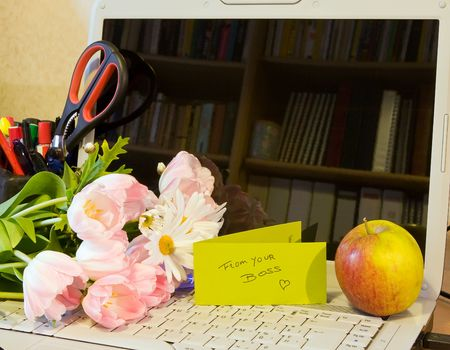 Office desk with flowers for secretary day photo