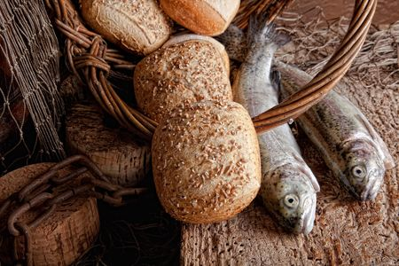 holy jug: Vintage still life of fresh fish and loaves of bread Stock Photo