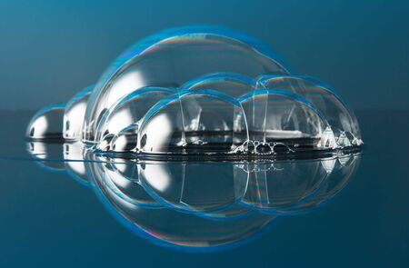 Just a few soap bubbles on a reflective surface photo