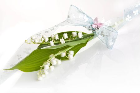 muguet: Simple twig of lilly of the valley with a soft pastel bow