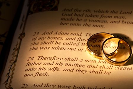 Rings and Bible with Genesis text of Adam and Eve, a typical wedding text - the book illustration is copied from a 400 years old bible. illustration