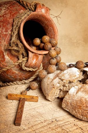 wooden cross: Antique wine jug, cross and rustic loaf of bread as christian symbols of faith