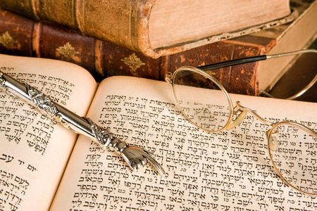 judaism: Silver Torah pointer lying on a jewish prayer book Stock Photo
