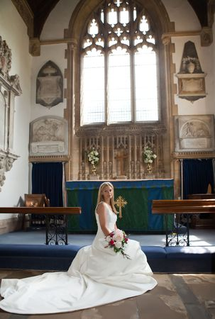 Young blonde bride posing in a medieval English church Stock Photo - 6538387