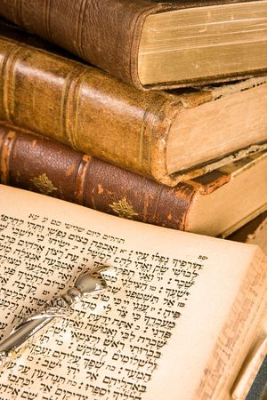 testament: Silver Torah pointer lying on a jewish prayer book Stock Photo