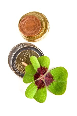 Four-leaf clover on a stack of euro coins Stock Photo - 6643920