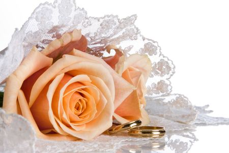 Wedding rings and roses lying on a lace veil Stock Photo - 6643952