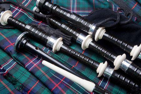 Gaita escocesa, acostado en una tradicional kilt Foto de archivo - 6643982