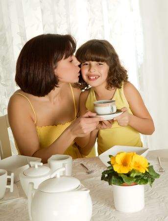 Little girl serving coffee for mothers day breakfast photo