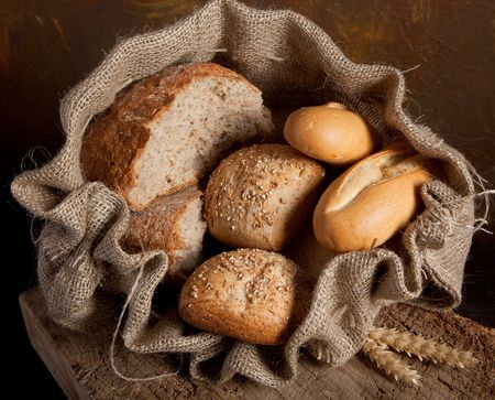 Vintage jute bag filled with fresh bread photo