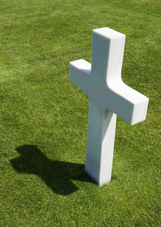 Single grave in a row at the American war Cemetery in Normandy, France photo