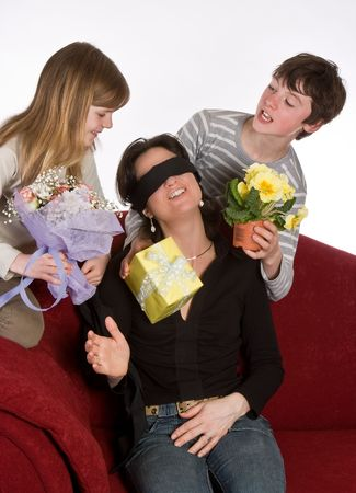surprising: Kids surprising their mother on mothers day Stock Photo
