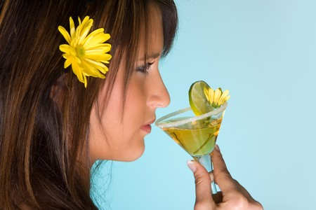 Young woman drinking a yellow summer cocktail Stock Photo - 6901204