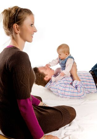 Happy mother watching her husband play with their four months old baby girl Stock Photo - 6901225
