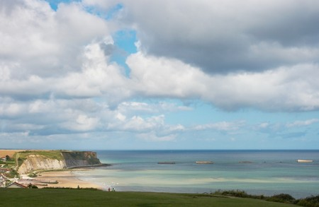 allied: View on the beaches of Normandy at Arromanches, France, with the remains of the artificial harbour used by the allied forces on D-Day (WWII)