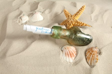 Holiday greetings sent as a message in a bottle on a beach photo