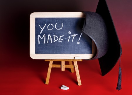 Graduation cap hanging on a blackboard with congratulations Stock Photo - 7010309