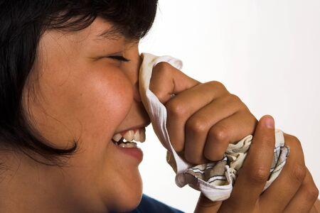 Boy sneezing in his handkerchief photo