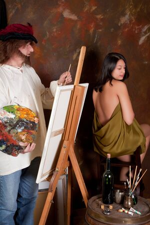 Vintage painter making a painting of a young nude model photo