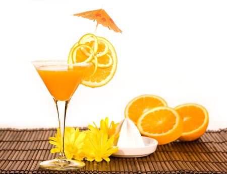 Cocktail with parasol and a yellow orange squeezer Stock Photo - 7117580