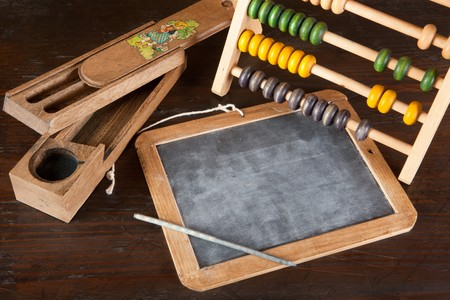 School image with antique slate and abacus photo
