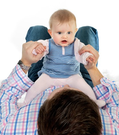 Four months old baby girl sitting on her father's belly Stock Photo - 7117614