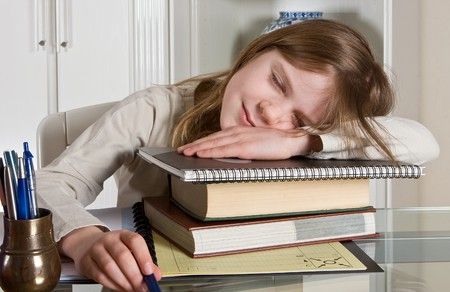 Teenager girl fallen asleep over her homework Stock Photo - 7117611