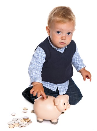 Little toddler boy playing with money and his piggy bank