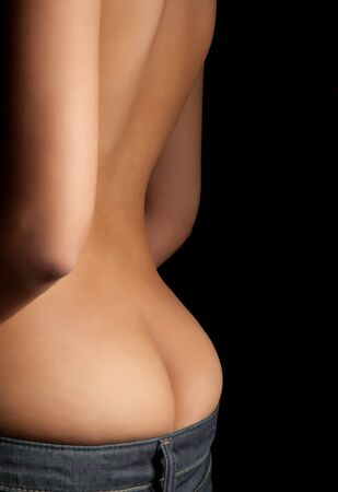 Fine art image of a naked young woman with only jeans