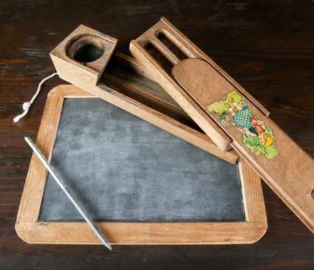school aged: Antique wooden slate and pencil with copy space Stock Photo