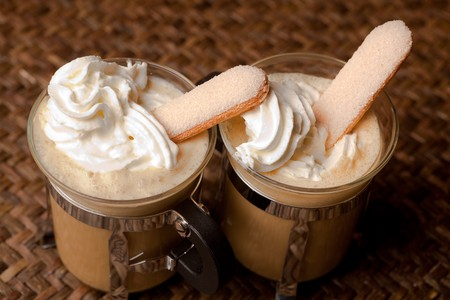 Two cups of coffee with whipped cream and biscuits Stock Photo - 7248022