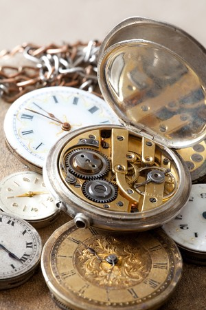 mechanism: Antique pocket watches with visible jewels inside Stock Photo