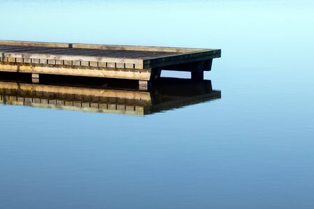 Rustic jetty on a zen-like idyllic lake in Aquitaine, France Stock Photo - 7332769